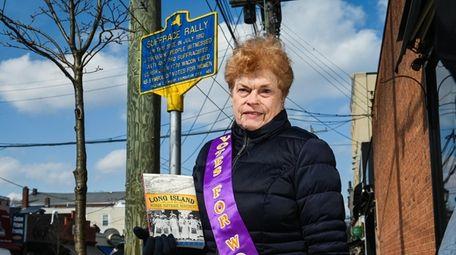 Antonia Petrash, of Glen Cove, holds her book,