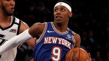 RJ Barrett of the Knicks drives against the