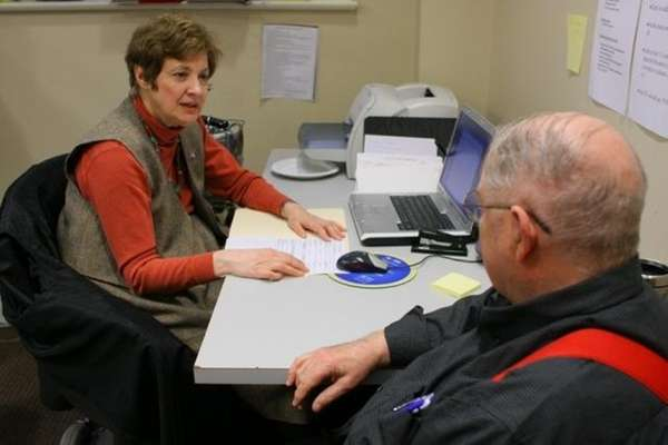 Anne Davis, helping a client at the Community