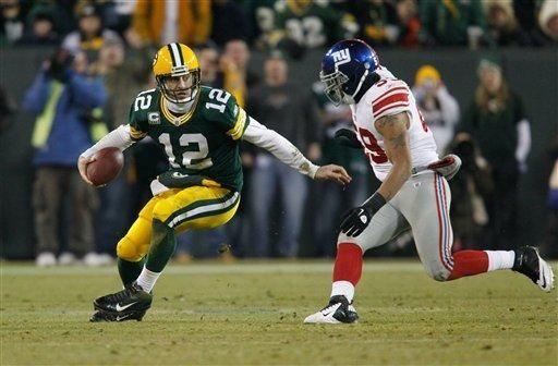 Green Bay Packers quarterback Aaron Rodgers breaks away