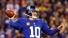 Eli Manning throws a pass during a game