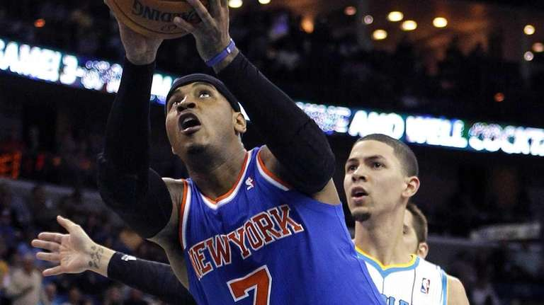 Carmelo Anthony drives to the basket ahead of