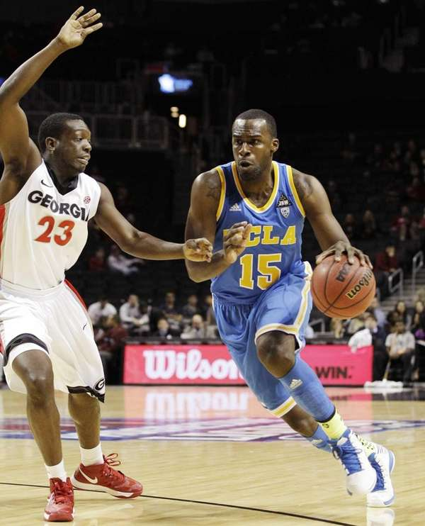 UCLA forward Shabazz Muhammad (15) drives to the