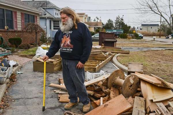 Massapequa resident Joe Demeo stands outside his home