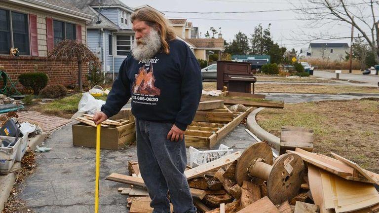 Massapequa resident Joe Demeo stands outside his home