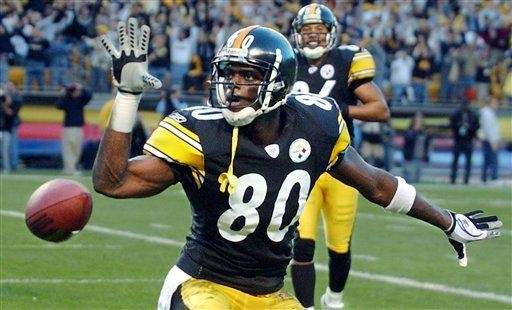 Plaxico Burress celebrates a touchdown during a game