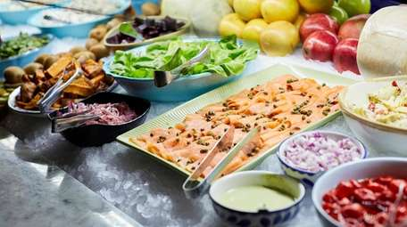 Smoked salmon and other salad bar offerings at