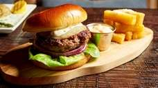 The provolone-draped picanha burger is available on the