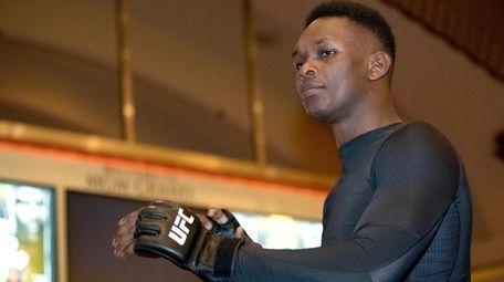UFC middleweight champion Israel Adesanya, of Nigeria, prepares