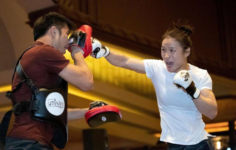 UFC women's strawweight champion Zhang Weili, right, of