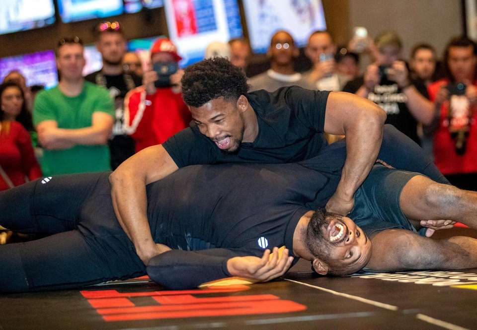 Middleweight fighter Yoel Romero, bottom, of Cuba wrestles