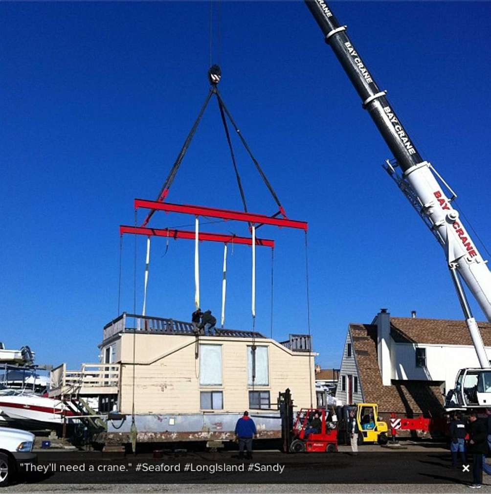 A Nassau County contractor moves a beached houseboat