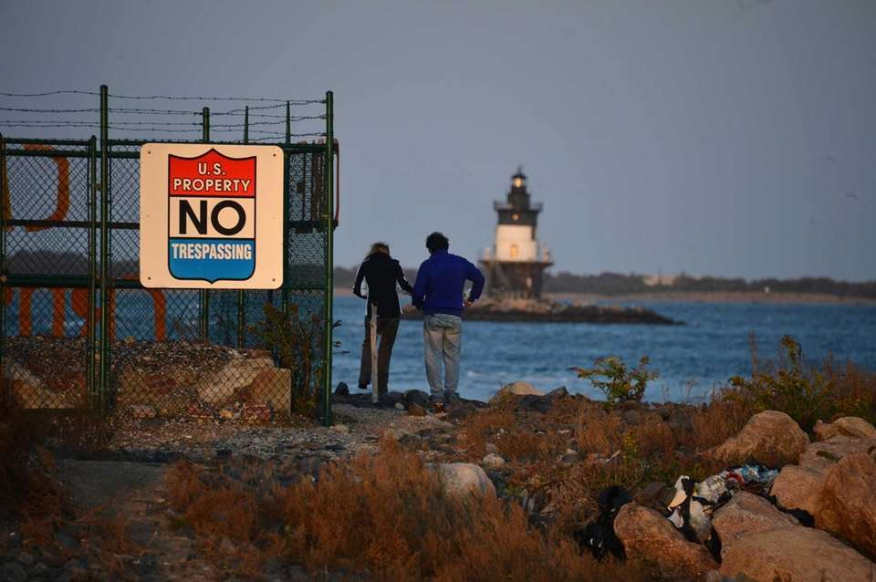 People gaze out at the Orient Point Lighthouse