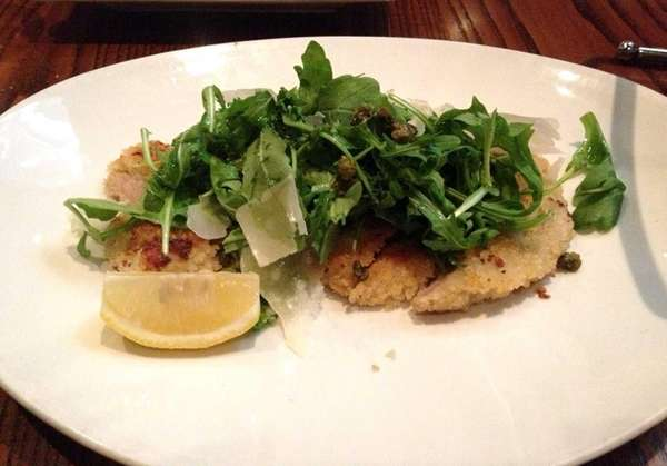 Veal Milanese topped with arugula, Parmesan and capers