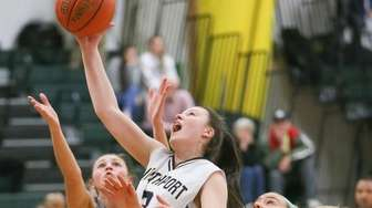 Northport's Kerry Dennin (30) grabs a rebound in