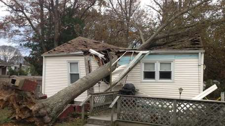 Ronkonkoma house destroyed by a tree after Hurricane