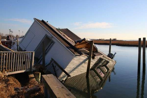 Beached and damaged house barges on Ocean Avenue