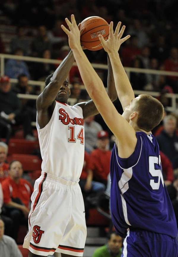 St. John's forward JaKarr Sampson shoots over Holy