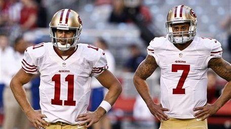San Francisco 49ers quarterbacks Alex Smith (11) and