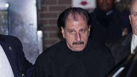 Salvatore Perrone, 63, of Staten Island, is walked