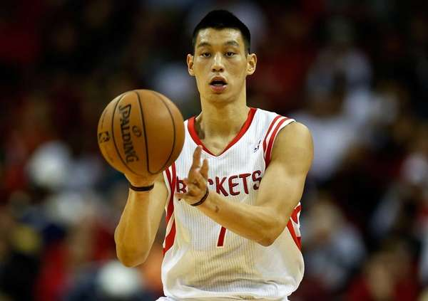 Houston Rockets guard Jeremy Lin passes the ball