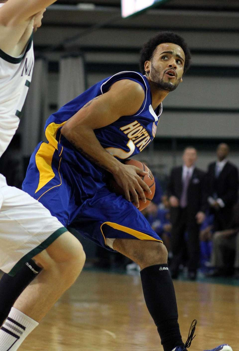 Hofstra's Taran Buie tries to drive as Manhattan's