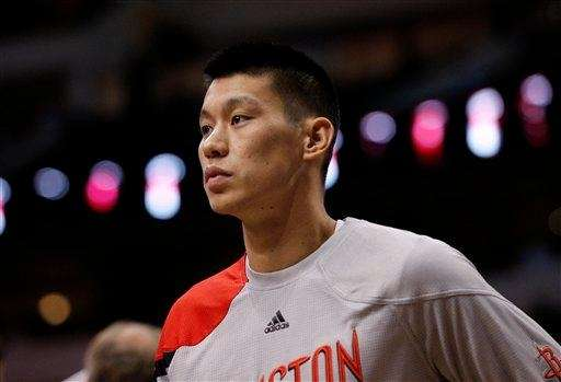 Houston Rockets guard Jeremy Lin watches late in