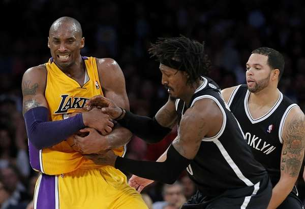 Los Angeles Lakers guard Kobe Bryant grabs a