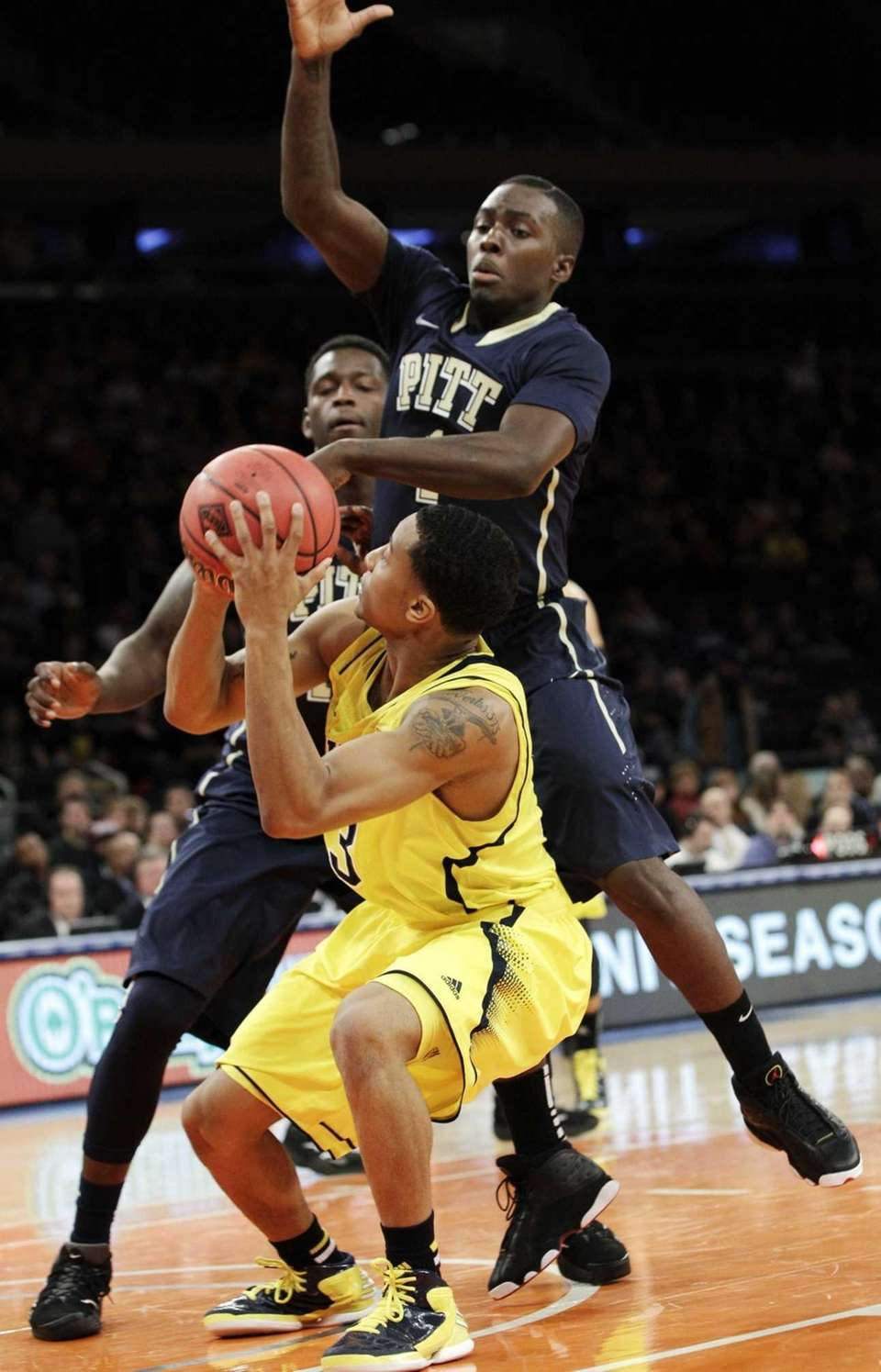 Pittsburgh guard Tray Woodall goes for the block