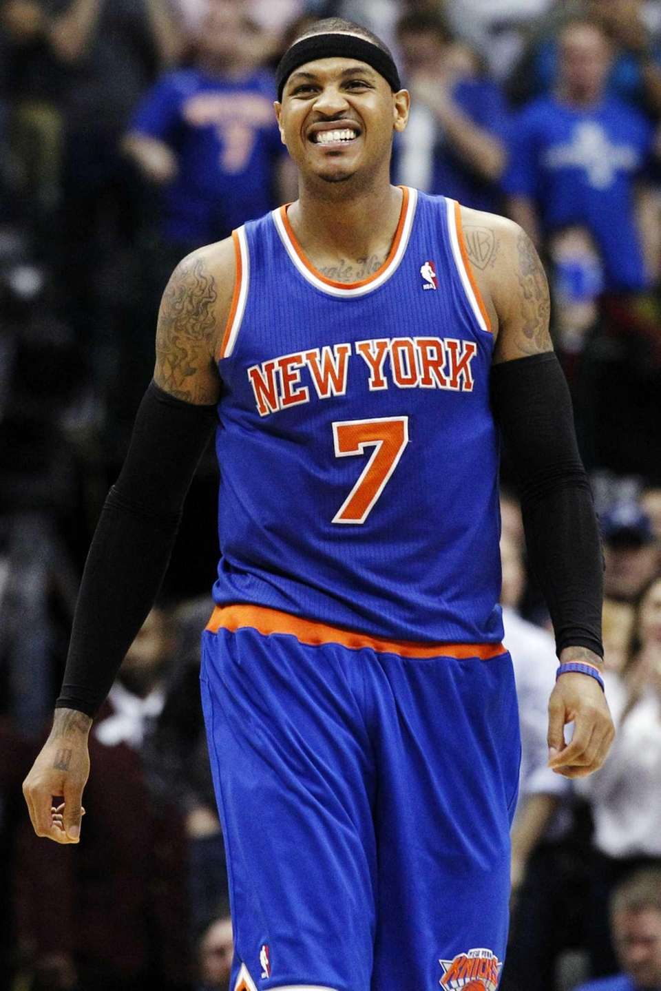 Carmelo Anthony reacts as he walks back to