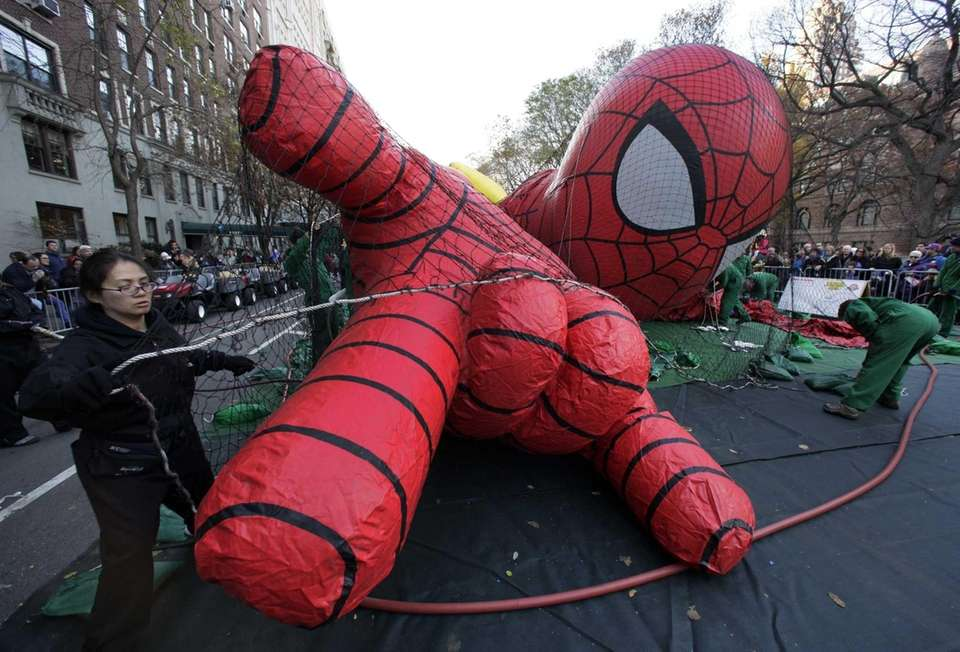 The Spider-Man balloon is put under a