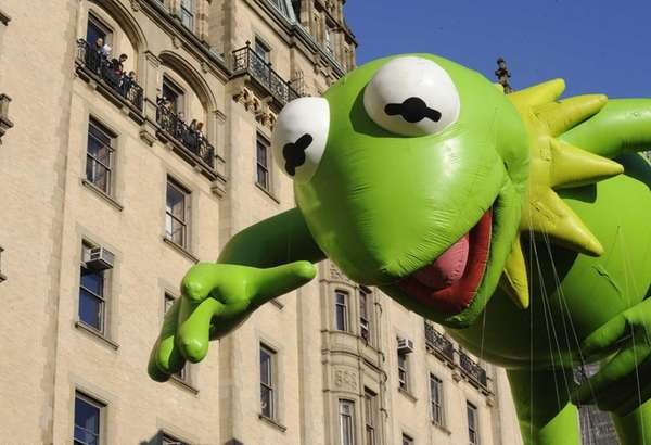 The Kermit the Frog balloon makes its way