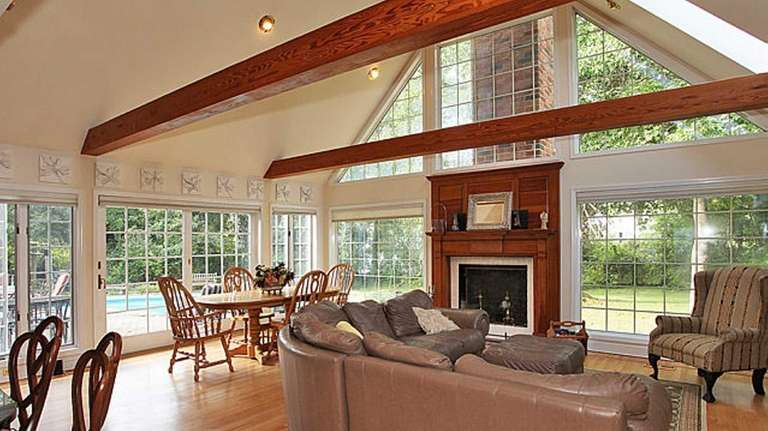 The fireplace in a Sayville home listed for