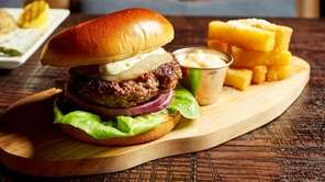The excellent house picanha burger is draped in
