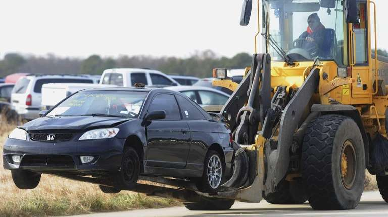 Cars damaged by superstorm Sandy were moved to