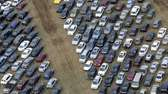Cars damaged by superstorm Sandy are being stored
