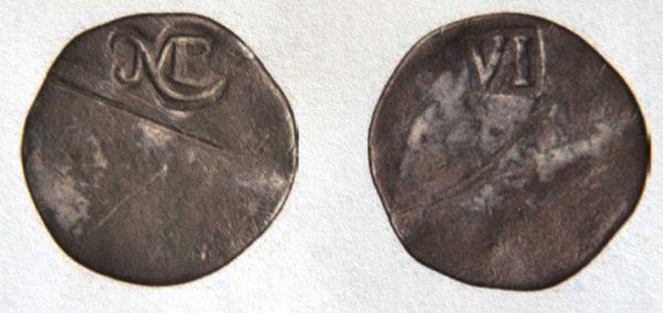 The 1652 New England sixpence.