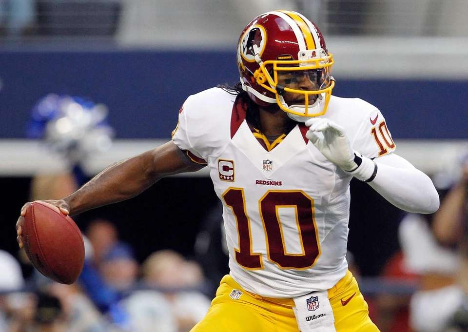 Robert Griffin III of the Washington Redskins scrambles