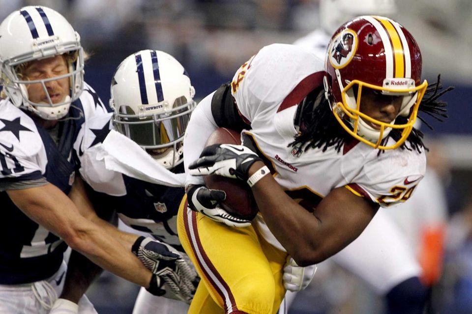 Washington Redskins strong safety DeJon Gomes escapes tackles