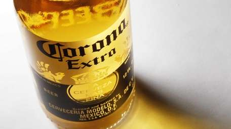 A bottle of Corona Extra beer sits on