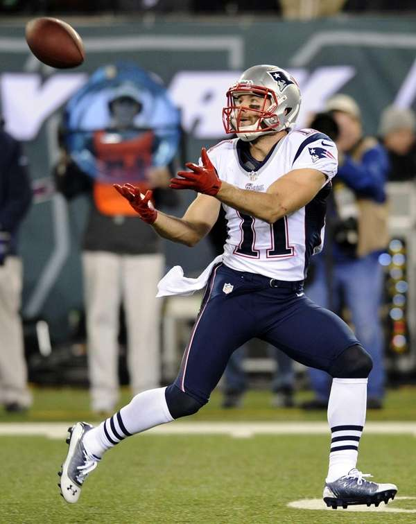New England Patriots wide receiver Julian Edelman catches