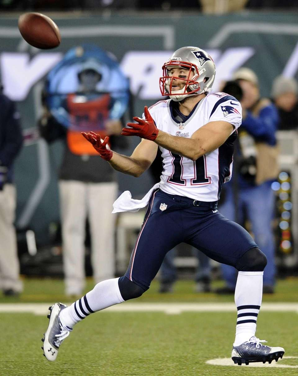 New England Patriots wide receiver Julian Edelman catches