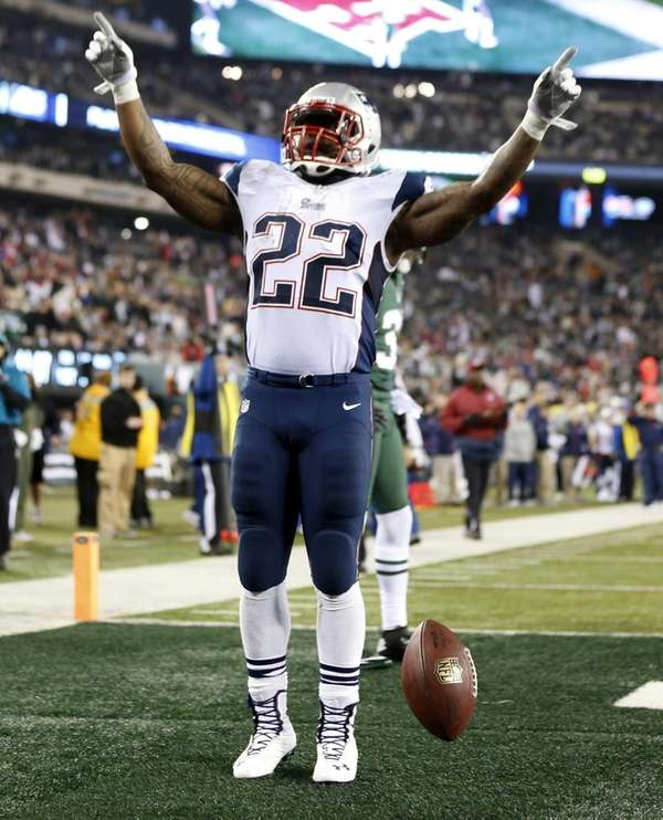 New England Patriots' Stevan Ridley celebrates after scoring