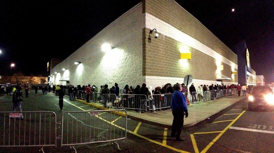 Hopeful buyers wait in a line outside Best