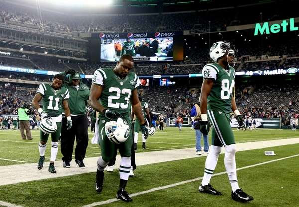Jeremy Kerley, Shonn Greene and Stephen Hill walk