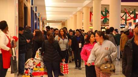 Shoppers fill the halls of the Roosevelt Field