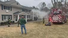 The Coram Fire Department battles a fire at