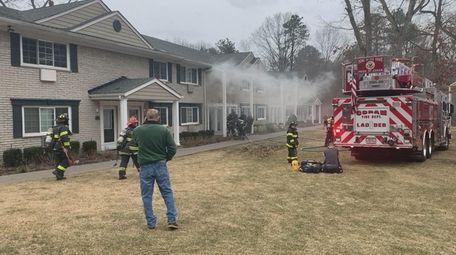 The Coram Fire Department battles a fire at