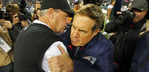 Jets head coach Rex Ryan hugs New England
