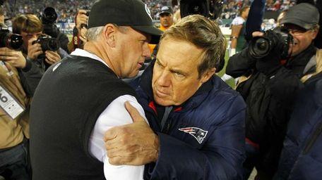 Jets head coach Rex Ryan hugs New England